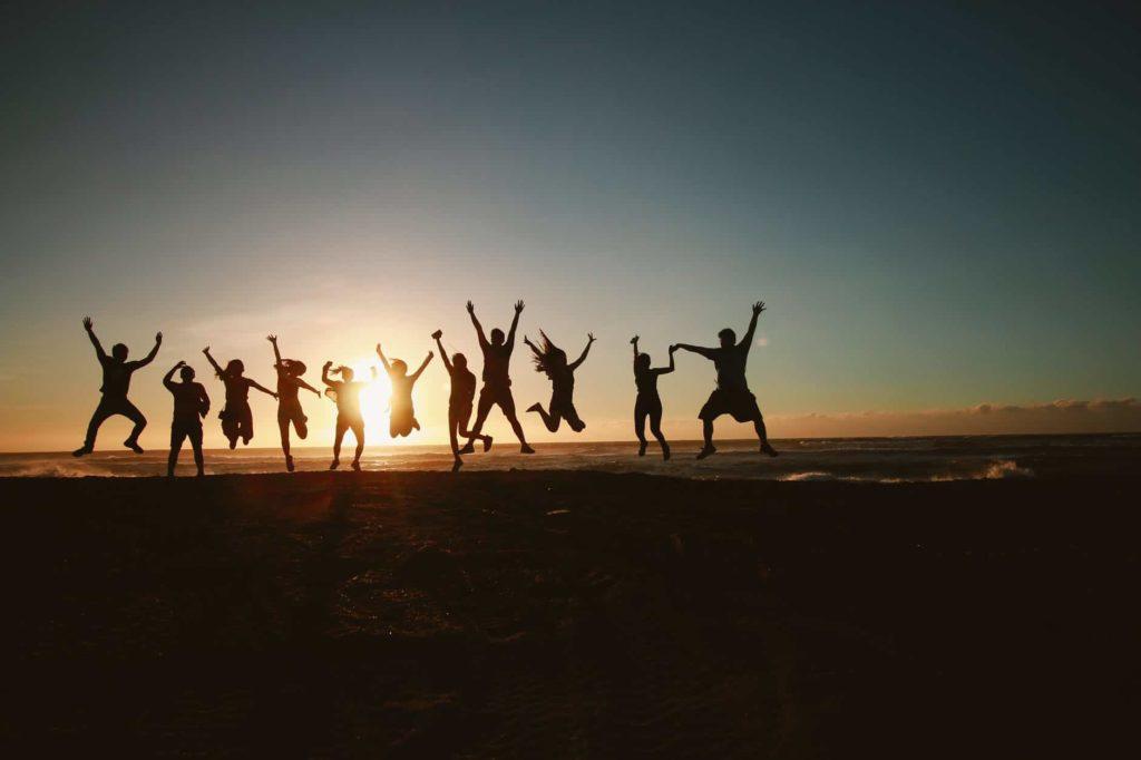 team celebration at sunset