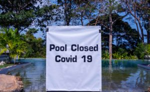 Sign the pool is closed because of covid infection.