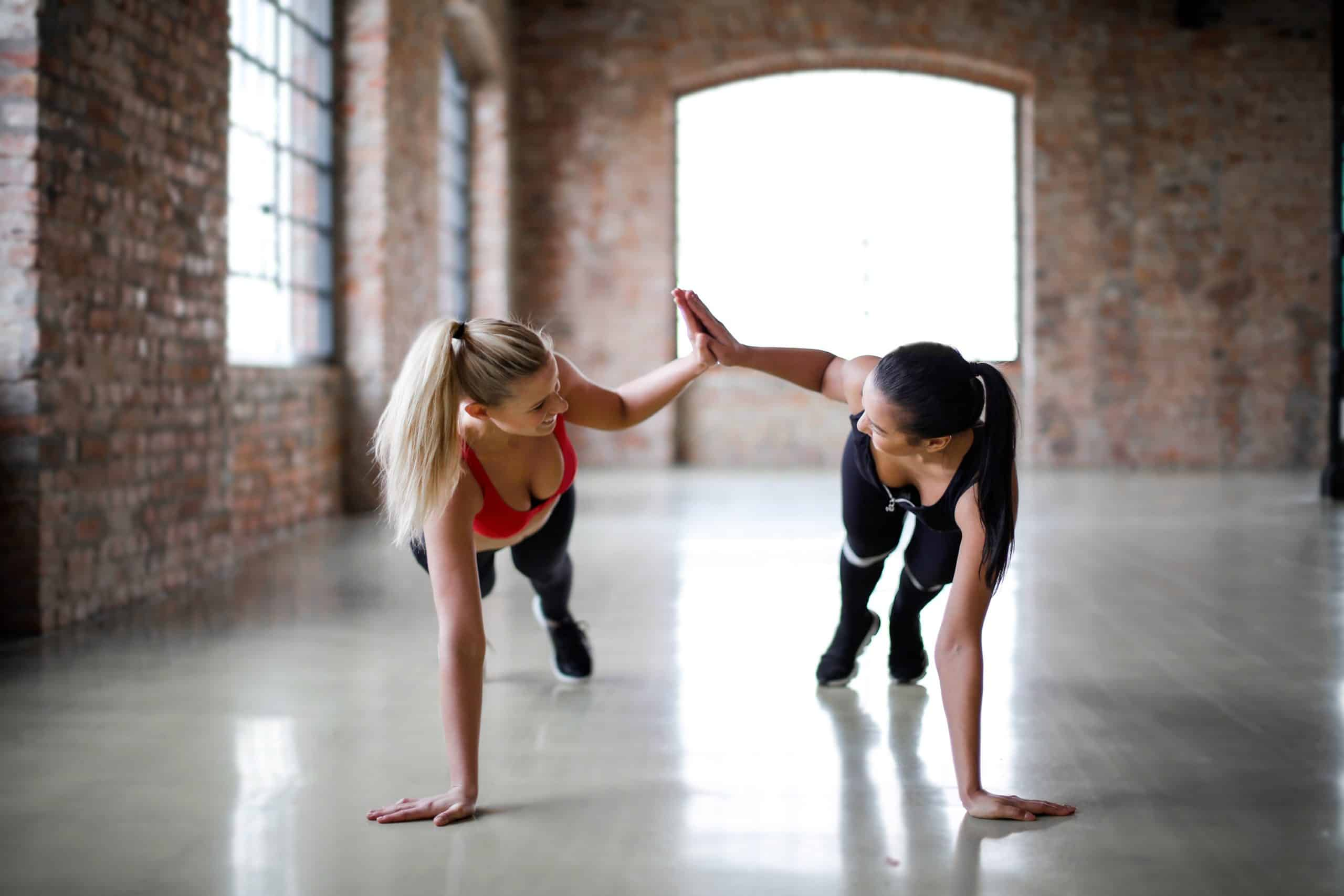 Women working out together in gym class