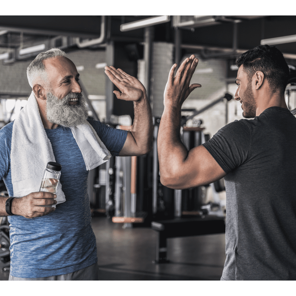 Cheerful males are talking to each other in modern gym-1