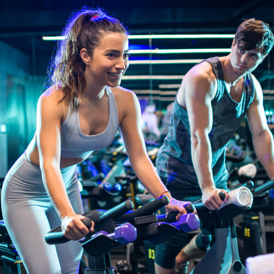 Young sporty couple doing spinning on cycle bikes -1